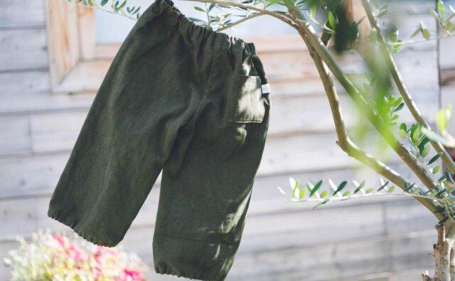 スモックパンツとオリーブの木